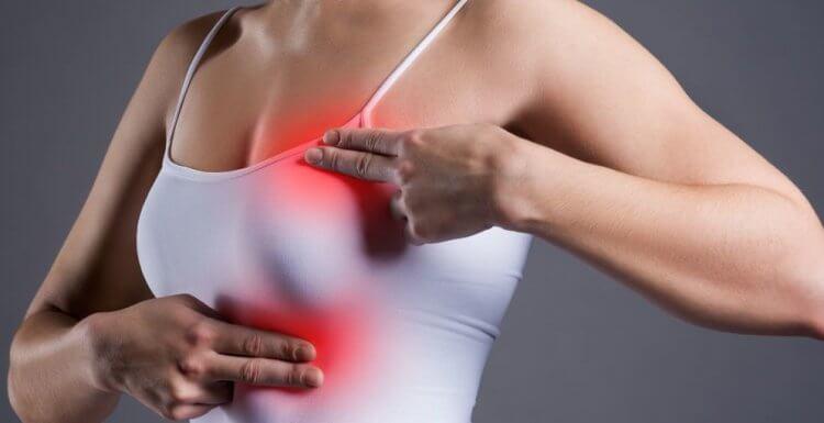 почему у девушек болит грудь